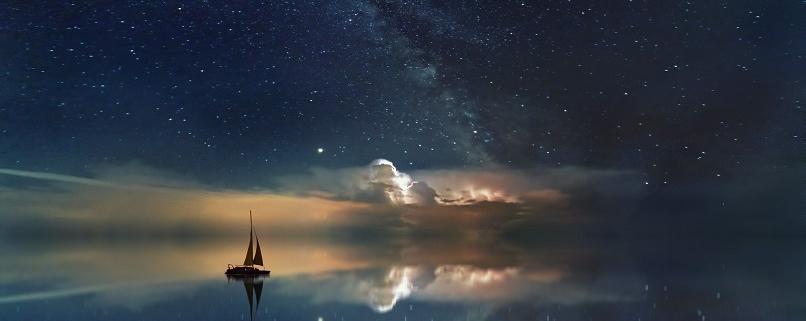 Ship on sea with night time sky